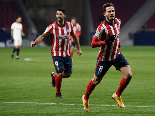 Atletico Madrid's Spanish midfielder Saul Niguez celebrates scoring his team's second goal during the Spanish League football match between Atletico Madrid and Sevilla at the Wanda Metropolitano stadium in Madrid.