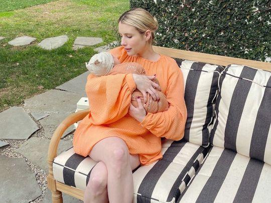Emma Roberts with her newborn son