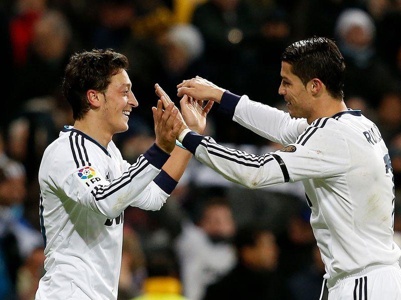 Mesut Ozil and Cristiano Ronaldo.