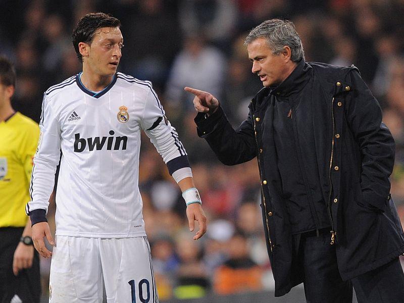 Mesut Ozil with Jose Mourinho.