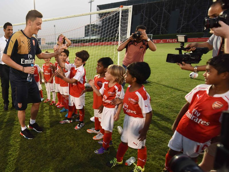 Mesut Ozil with young fans.