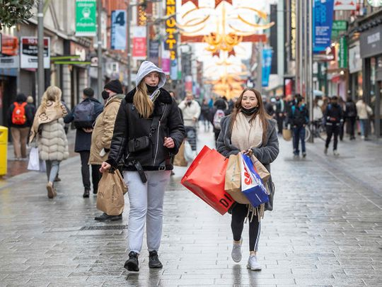 Pedestrians shop in advance of a new coronavirus lockdown in Dublin on December 31, 2020.