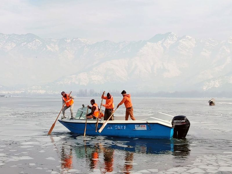 Jammu and Kashmir, : SDRF teams deployed at Dal Lake after it freezes due to drop in temperature, in Srinagar on Thursday.