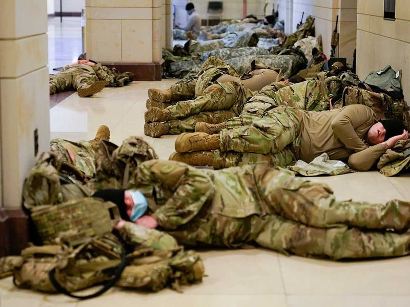Military Police sleep in the Dirksen Senate Office Building