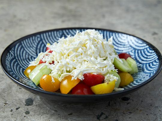 The shopska salad is full of juicy tomatoes and crunchy cucumbers