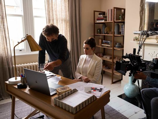 This image released by HBO Max shows director Doug Liman, left, with actress Anne Hathaway on the set of