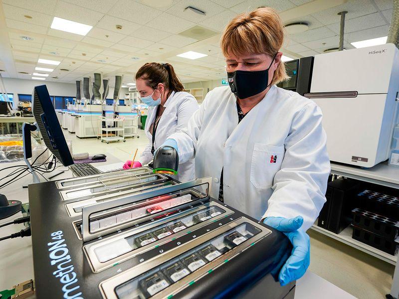 Scientists at deCODE genetics are seen working in the laboratorium in Reykjavik, Iceland.