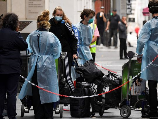 Tennis players, coaches and officials arrive in Melbourne before quarantining for two weeks ahead of the Australian Open