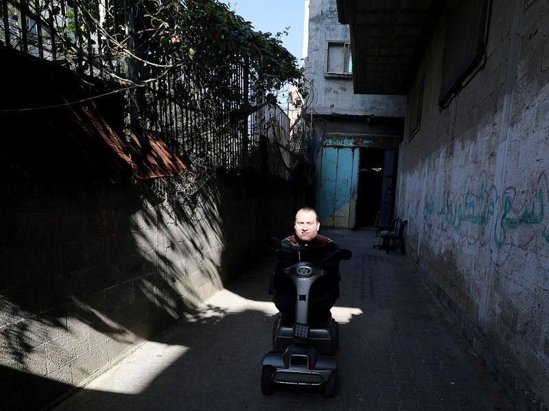 Youssef Abu Amira leaves his home in Gaza City.