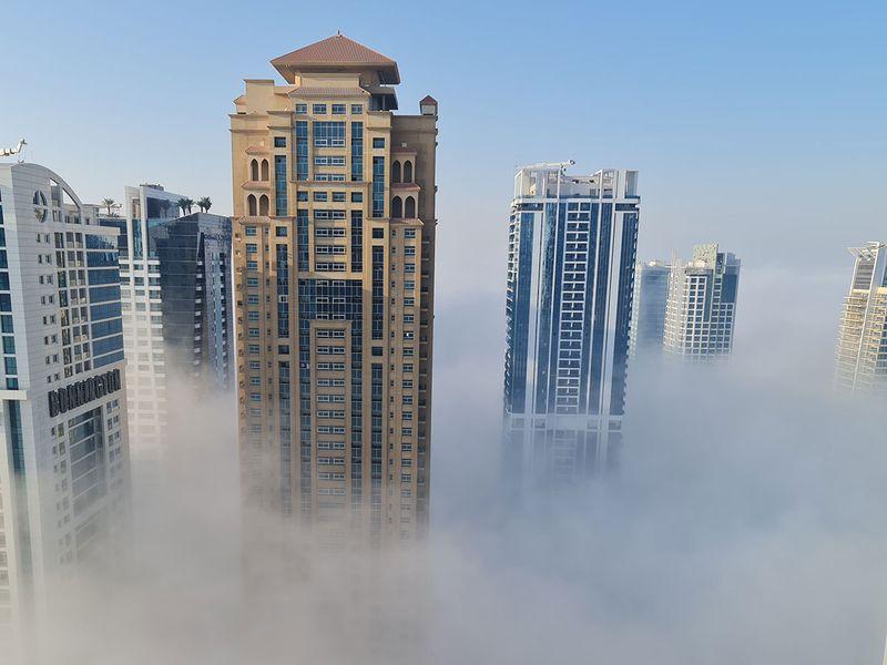 Fog covers building in Jumeirah Lake Towers