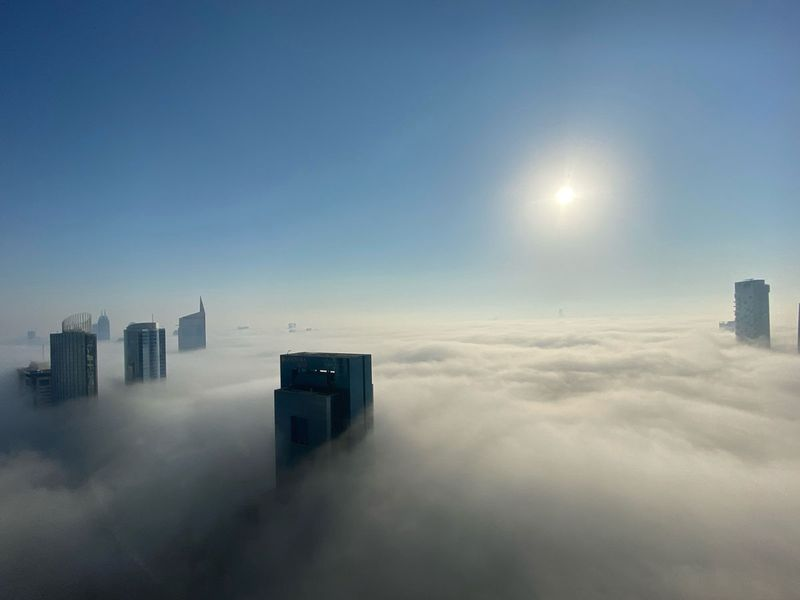 Fog in Dubai Marina, overlooking Sheikh Zayed Road and the Golf Course