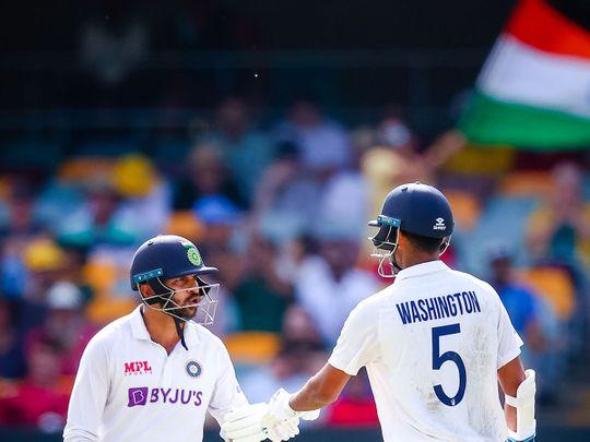 India's Washington Sundar (R) and Shardul Thakur during the fourth Test against Australia