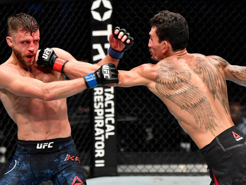 Max Holloway punches Calvin Kattar during UFC Fight Island 7 in Abu Dhabi