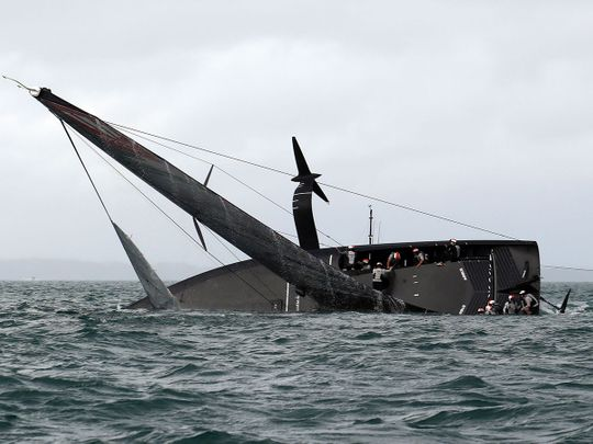 New York Yacht Club American Magic capsizes during Round Robin two, Race three against Luna Rossa during the Prada Cup 2021, the challengers series of the 36th America's Cup in Auckland on January 17