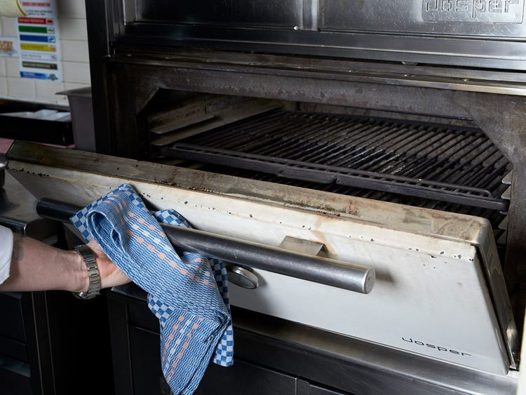 Checking heat while using a grill