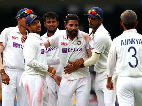 India's paceman Mohammed Siraj celebrates his fifth wicket against Australia