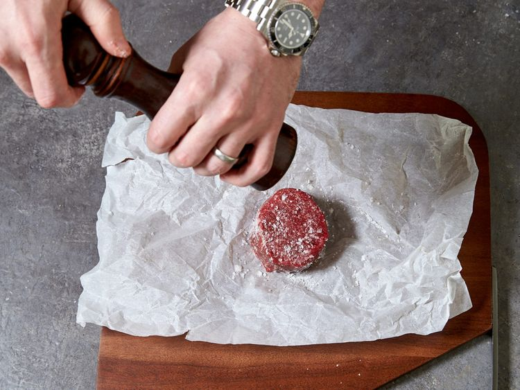 Marinating the steak with pepper