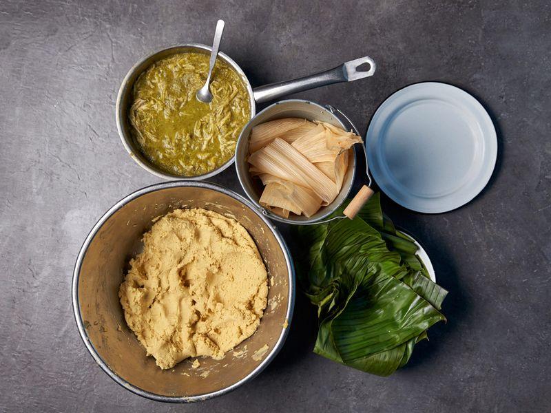 Masa dough, salsa verde with chicken, banana leaves and corn husks