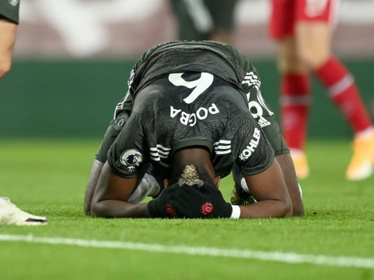 Paul Pogba looks defeated during goalless match against Liverpool at Anfield.