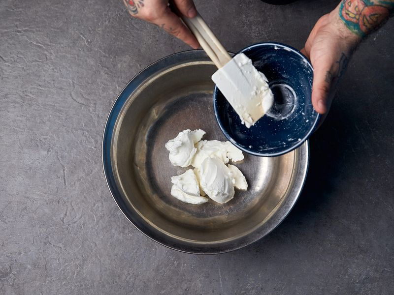 Soften the lard in a large bowl