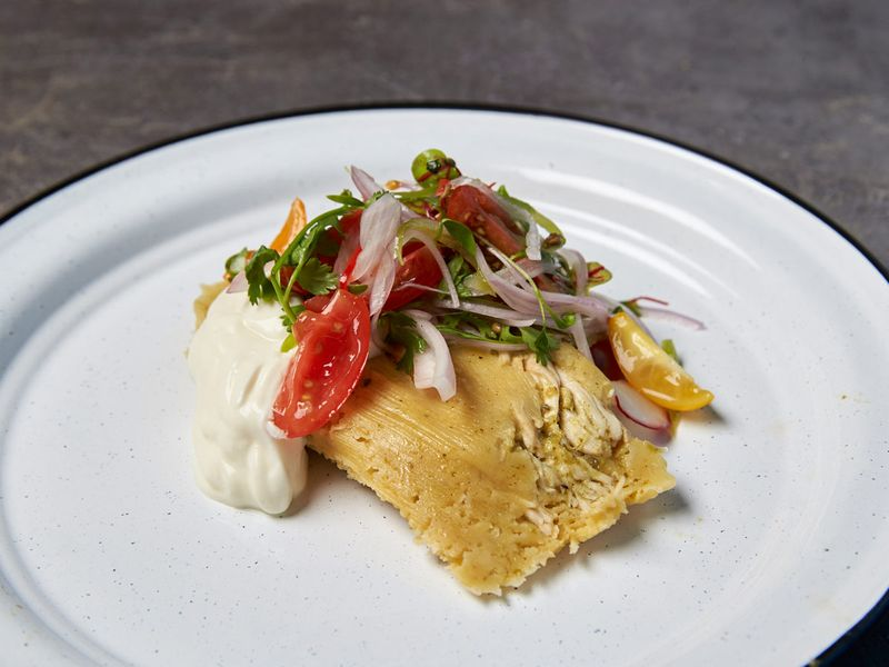 Tamales with sour cream, habanero chillies and salad