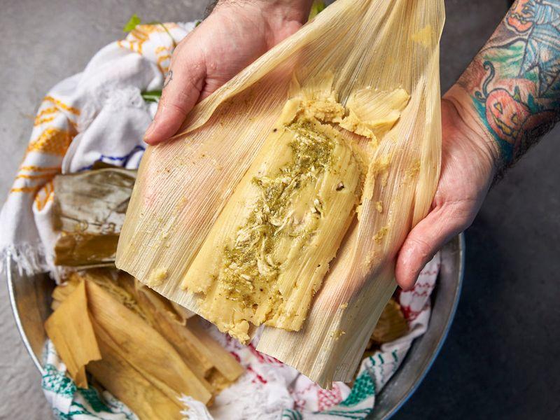 Unwrapping corn husk tamales