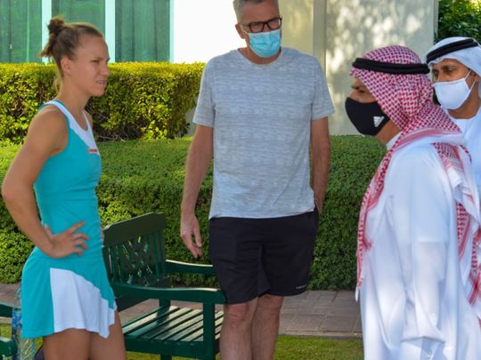 Abdul Ghafoor Behroozian, Chairman of the Fujairah Tennis and Country Club, speaks with a competitor at the Fujairah International Women Tournament