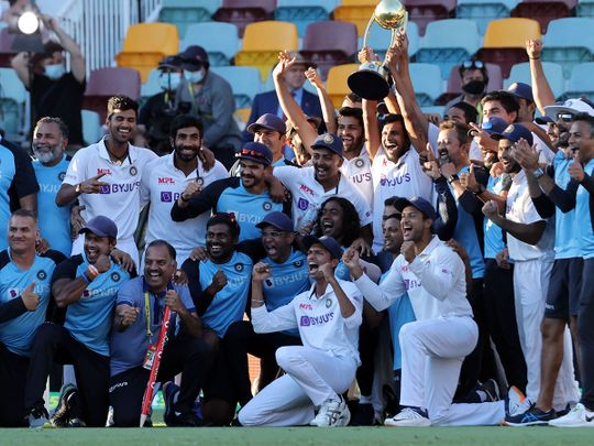 India celebrates their series win over Australia with the Border-Gavaskar trophy at the Gabba