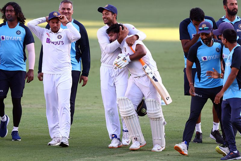 India's Rishabh Pant (C) celebrates victory with teammates at the end of the fourth cricket Test match between Australia and India at The Gabba in Brisbane on January 19, 2021.