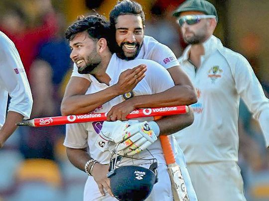 India's Shardul Thakur and Mohammad Siraj celebrate after defeating Australia by three wickets at the Gabba, Brisbane