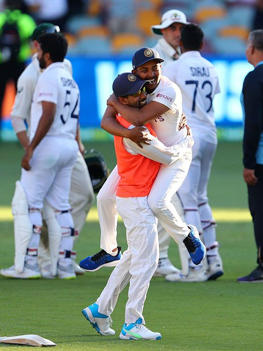 Indian players celebrate after defeating Australia by three wickets on the final day of the fourth cricket test at the Gabba, Brisbane, Australia, Tuesday, Jan. 19, 2021.India won the four test series 2-1.