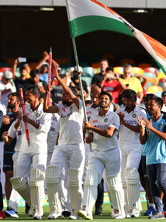 Indian players celebrate after defeating Australia by three wickets on the final day of the fourth cricket test at the Gabba, Brisbane, Australia, Tuesday, Jan. 19, 2021.