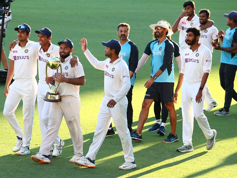 Indian players celebrate with their trophy after defeating Australia by three wickets on the final day of the fourth cricket test at the Gabba, Brisbane, Australia, Tuesday, Jan. 19, 2021.India won the four test series 2-1.