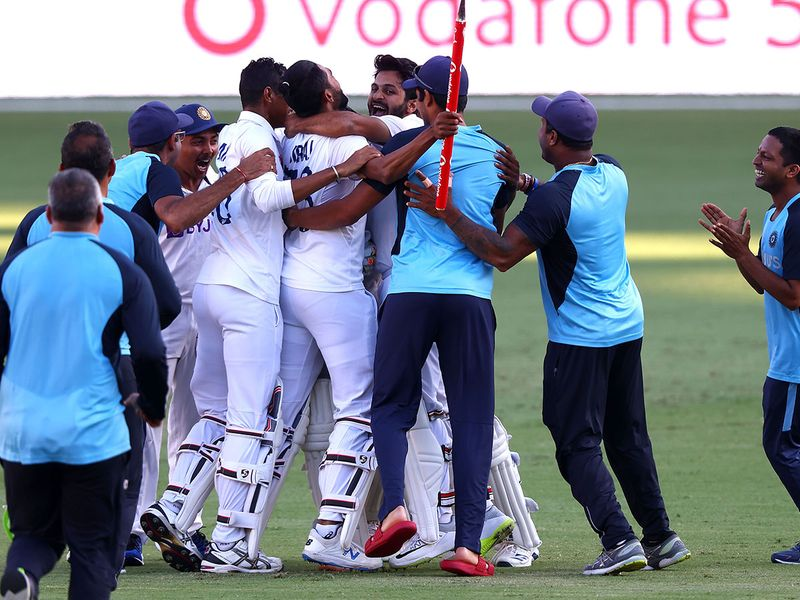Indian players celebrates victory in the fourth cricket Test match against Australia at The Gabba in Brisbane on January 19, 2021.