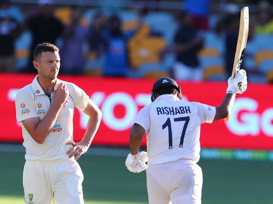 Australia's Josh Hazlewood reacts as India's Rishabh Pant