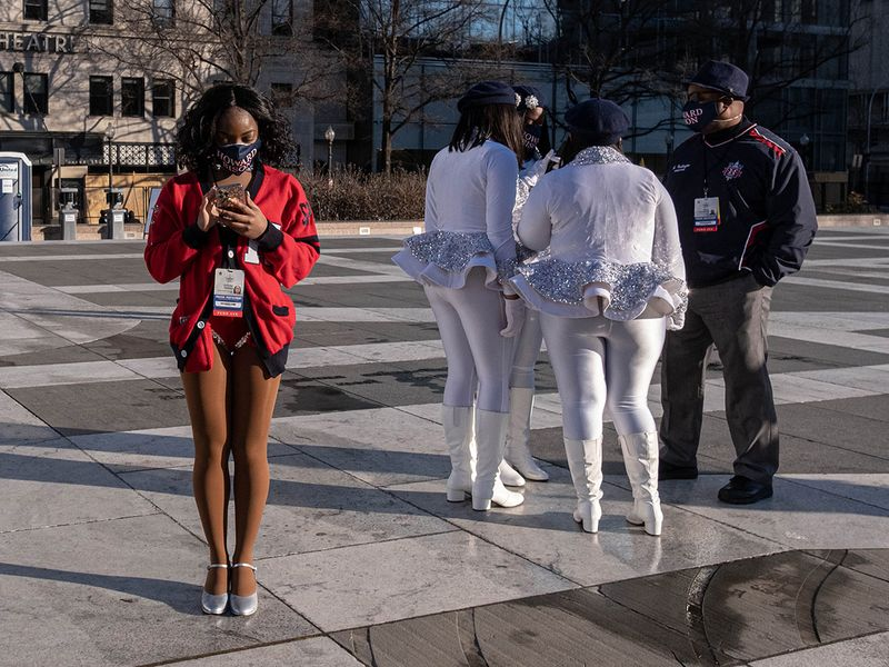 Dance team members from Howard University wait at Freedom Plaza for the start of the inauguration parade in Washington, DC.
