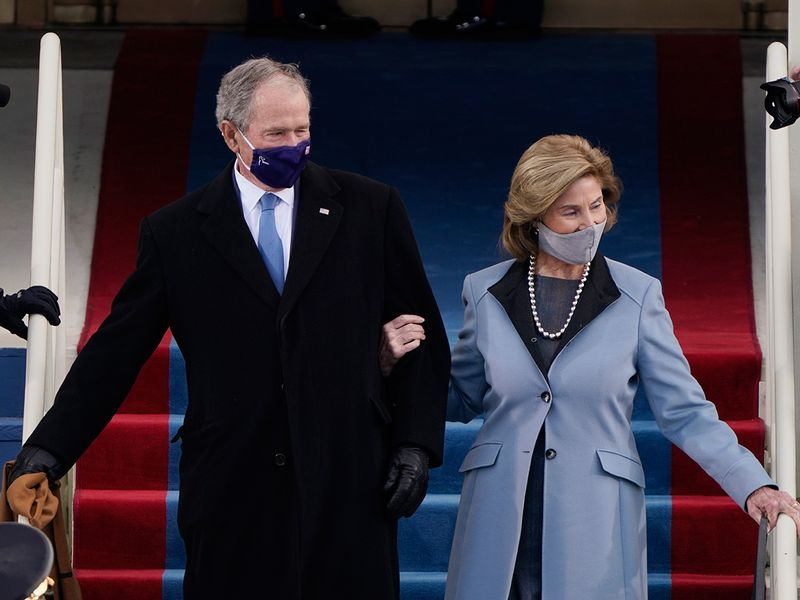 Former President George W. Bush and his wife Laura arrive for the 59th Presidential Inauguration.