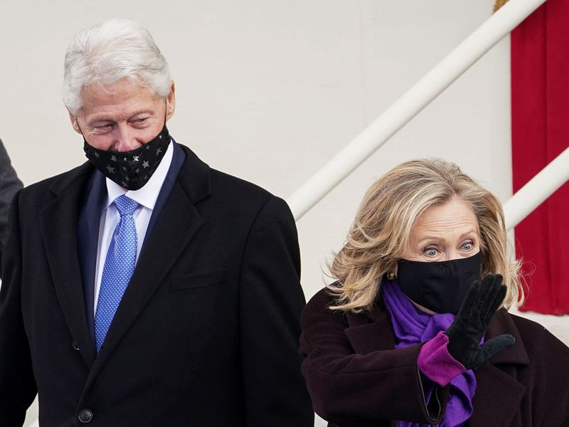 Former US Secretary of State Hillary Clinton and former US President Bill Clinton arrive for the inauguration, on the West Front of the US Capitol in Washington.