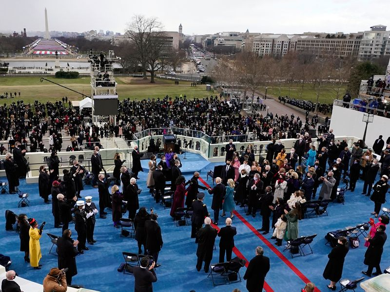 Joe Biden, with his wife Jill, steps out to the portico to be sworn in as 46th president of the United States during the 59th Presidential Inauguration at the US Capitol.