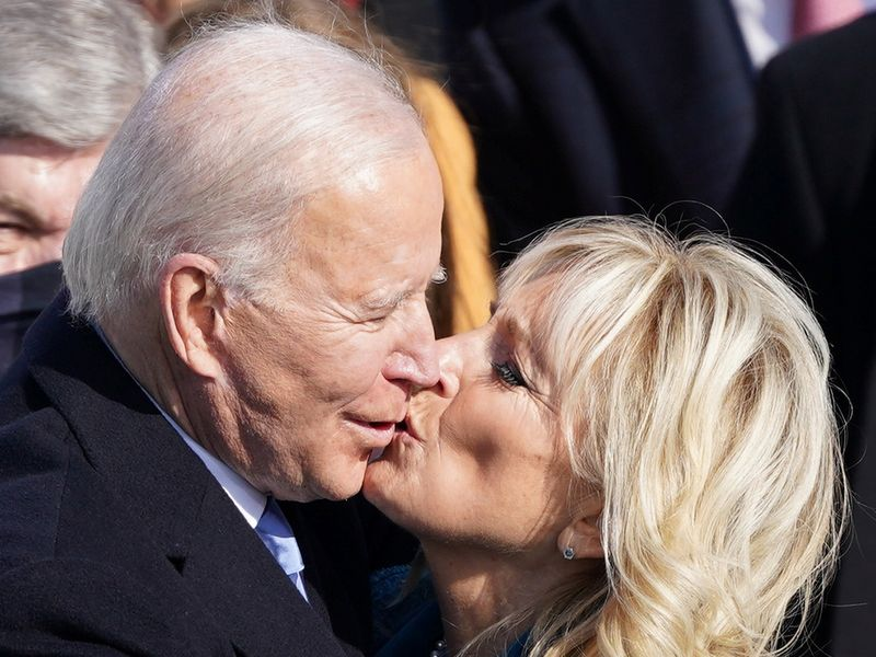 Joe Biden and his wife Jill Biden kiss after he was sworn in as the 46th President of the United States on the West Front of the US Capitol in Washington.