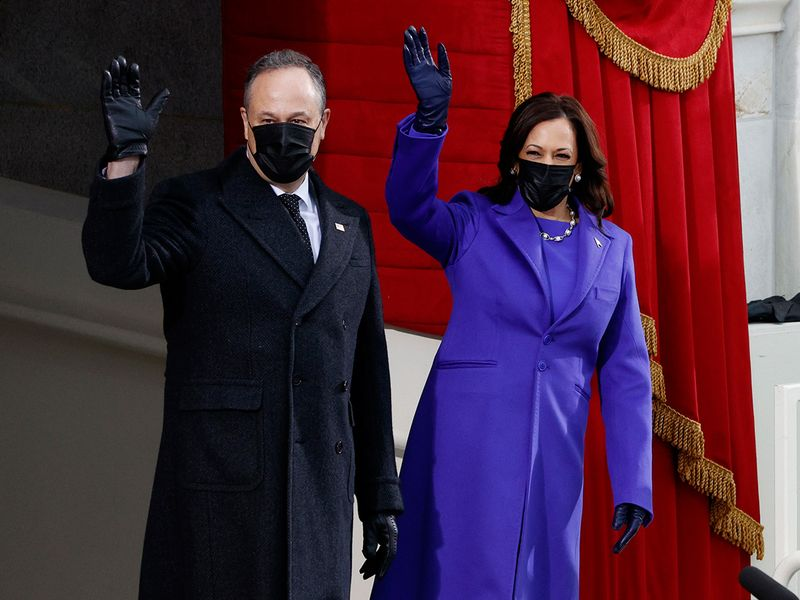 Kamala Harris and her husband Doug Emhoff arrive before the inauguration on the West Front of the US Capitol.