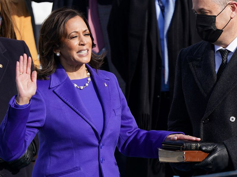 Kamala Harris is sworn in as US Vice President as her spouse Doug Emhoff holds a bible during the inauguration of Joe Biden on the West Front of the US Capitol in Washington.