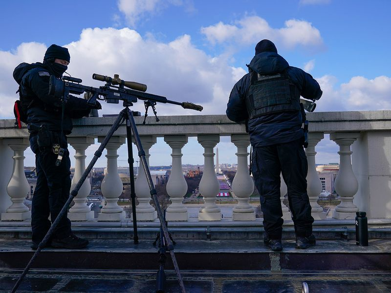 Law enforcement personnel monitor the area during the 59th Presidential Inauguration at the US Capitol in Washington.
