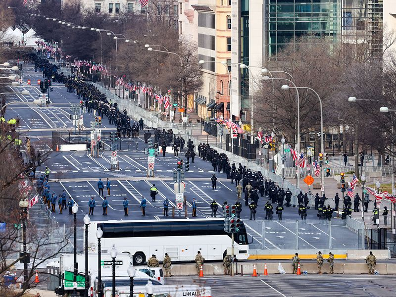 Members of law enforcement line the streets ahead of the inauguration of President-elect Joe Biden in Washington, DC.