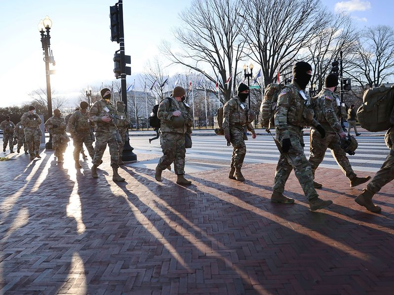 Members of the National Guard patrol the streets ahead of the inauguration in Washington, DC.