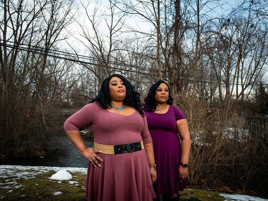 Twins Kimberly, left and Kelly Standard in Rochester, covid