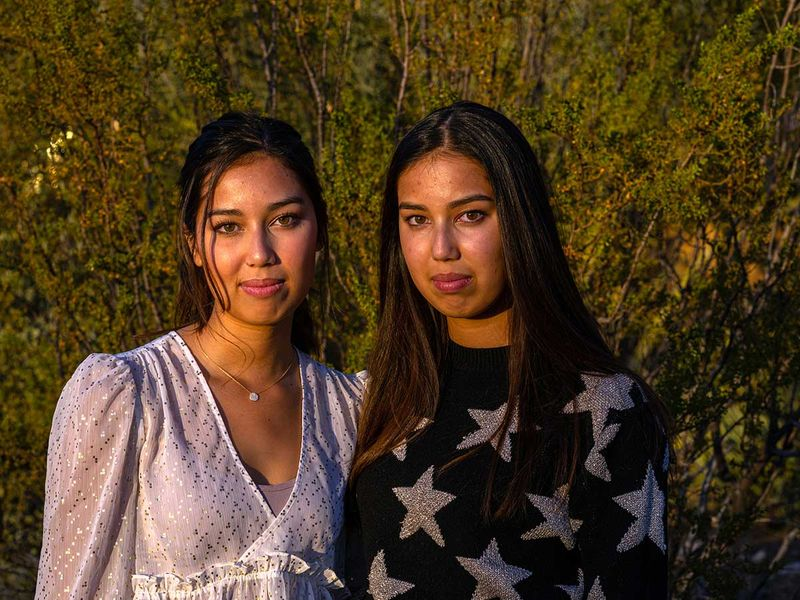 Twins Marena, left, and Vivian Herr in Scottsdale covid