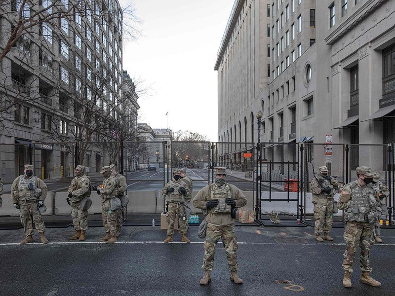 US National Guardsmen look on in Washington, DC, ahead of the inauguration.