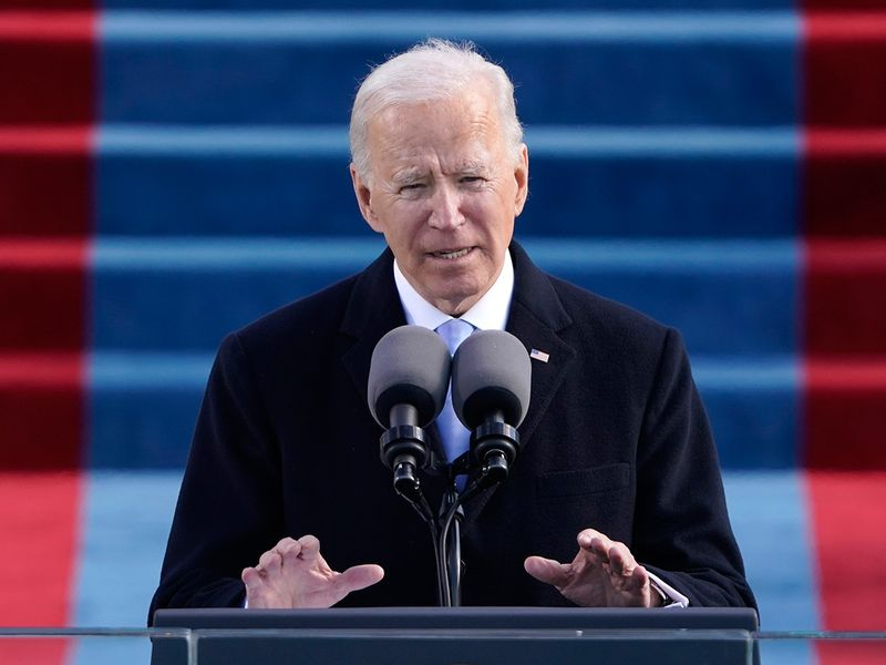 US President Joe Biden speaks during the 59th Presidential Inauguration at the US Capitol in Washington.