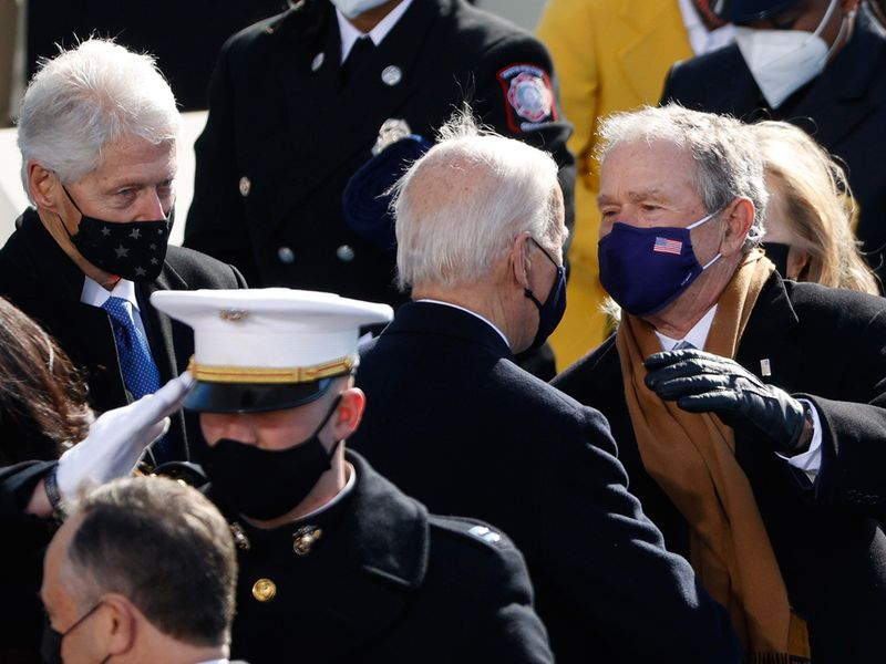 US President Joe Biden with former Presidents George W. Bush and Bill Clinton during the inauguration on the West Front of the US Capitol in Washington.